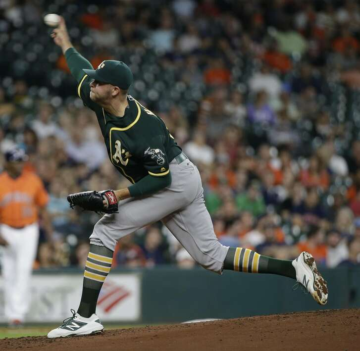 Oakland Athletics Jesse Hahn pitches against the Houston Astros during the first inning of MLB game at Minute Maid Park Friday, June 3, 2016, in Houston.  ( Melissa Phillip / Houston Chronicle )