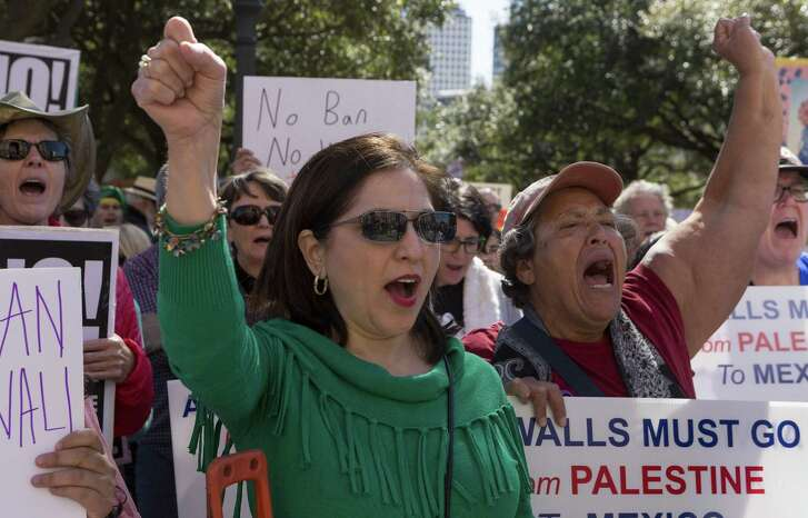 """Marta Lopez and Petra Guerra cheer during the """"No ban, no wall"""" rally at the Texas Capitol in Austin, Saturday, Feb. 25. 2017. The event was to show support of immigrant and refugee rights. (Stephen Spillman for Express-News)"""
