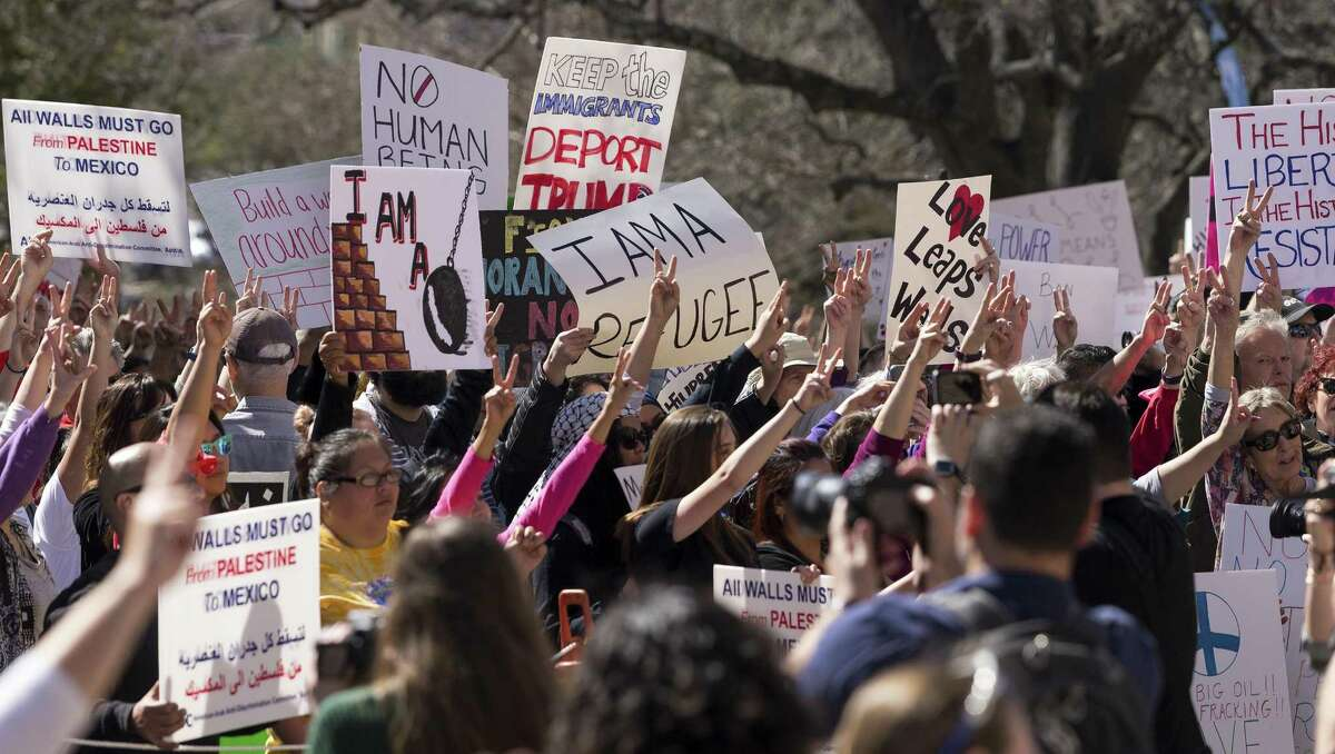 """""""No ban, no wall"""" rally at the Texas Capitol in Austin, Saturday, Feb. 25. 2017. The event was to show support of immigrant and refugee rights. (Stephen Spillman for Express-News)"""