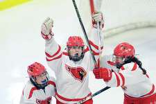 Surrounded by two of her teammates, Jennifer Kelly celebrates her goal, the second of the third period for Greenwich during the FCIAC girls ice hockey championship game between Greenwich High School and Darien High School at Terry Conners Rink in Stamford, Conn., Saturday, Feb. 25, 2017. Greenwich took the FCIAC title with a 2-0 victory as GHS goalie Jessica Ware was declared the MVP for her shutout..