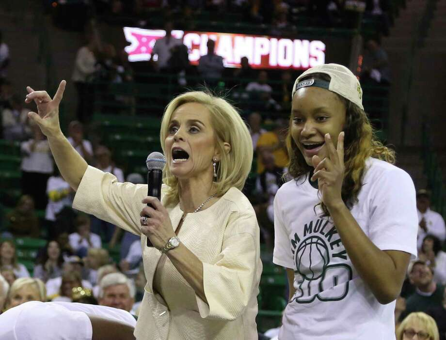 Baylor head women's coach Kim Mulkey celebrates her 500th career win with forward Nina Davis, right, following an NCAA college basketball game against Texas Tech, Saturday, Feb. 25, 2017, in Waco, Texas. Baylor won 86-48. (AP Photo/Rod Aydelotte) Photo: Rod Aydelotte, Associated Press / FRE36102 AP