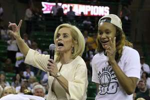 Baylor head women's coach Kim Mulkey celebrates her 500th career win with forward Nina Davis, right, following an NCAA college basketball game against Texas Tech, Saturday, Feb. 25, 2017, in Waco, Texas. Baylor won 86-48. (AP Photo/Rod Aydelotte)