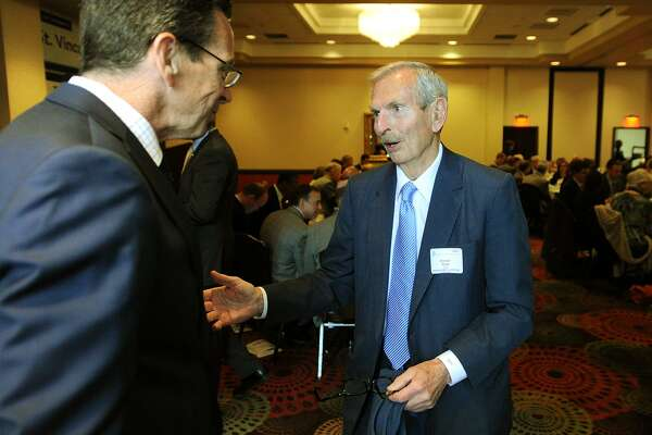 Governor Dannel P. Malloy, left, chats with Ernest Trefz of Trefz Corporation at the Bridgeport Regional Business Council's Capitol Luncheon at the Holiday Inn  in Bridgeport, Conn. on Thursday, April 16, 2015.