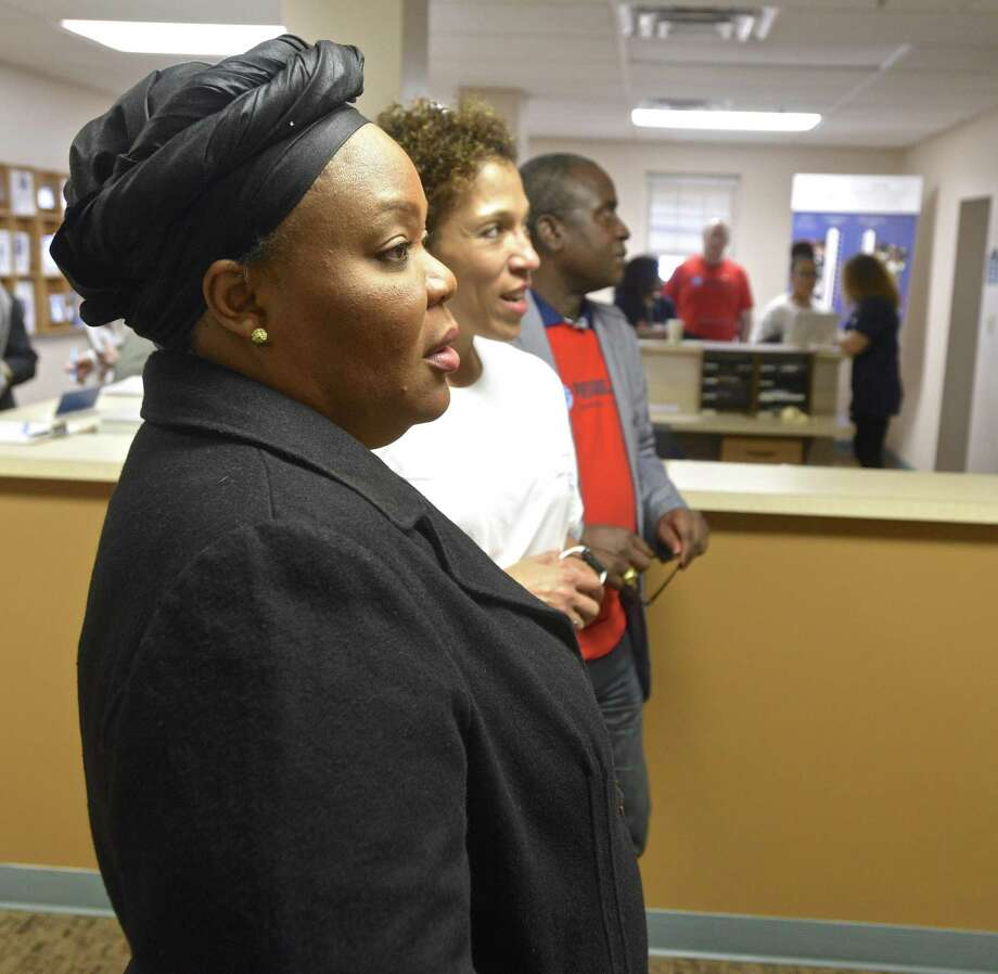 Leymah Gbowee, awarded the 2011 Nobel Peace Prize, looks over the murals in the Jericho Partnership lobby with Jericho President Carrie Amos, right, during a tour of the Danbury facility. Gbowee was visiting Jericho during the 2017 PeaceJam Conference. Saturday, February 25, 2017, in Danbury, Conn. Photo: H John Voorhees III / Hearst Connecticut Media / The News-Times