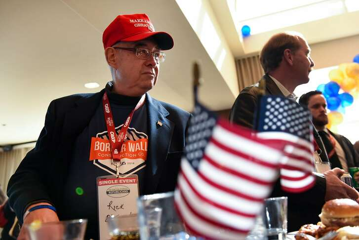 Rick Oltman, former proponent of Prop 187, looks on as guests mingle at Trump Delegation Reunion gathering during the California Republican Party's 2017 Organizing Convention in Sacramento, CA, on Saturday February 25, 2017.