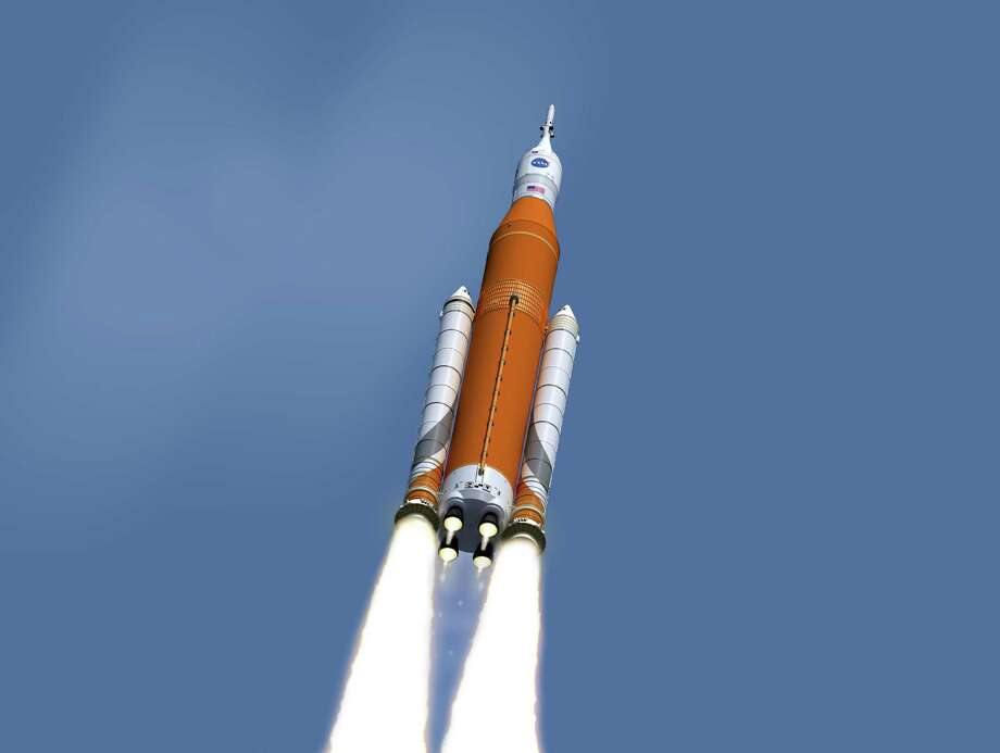 This image made available on Feb. 15, 2017 by NASA shows an artist's concept of the launch of the Space Launch System rocket and Orion capsule. On Friday, Feb. 24, 2017, NASA said it is weighing the risk of adding astronauts to the first flight of its new megarocket. (NASA/Marshall Space Flight Center via AP) Photo: HOGP / NASA/Marshall Space Flight Center