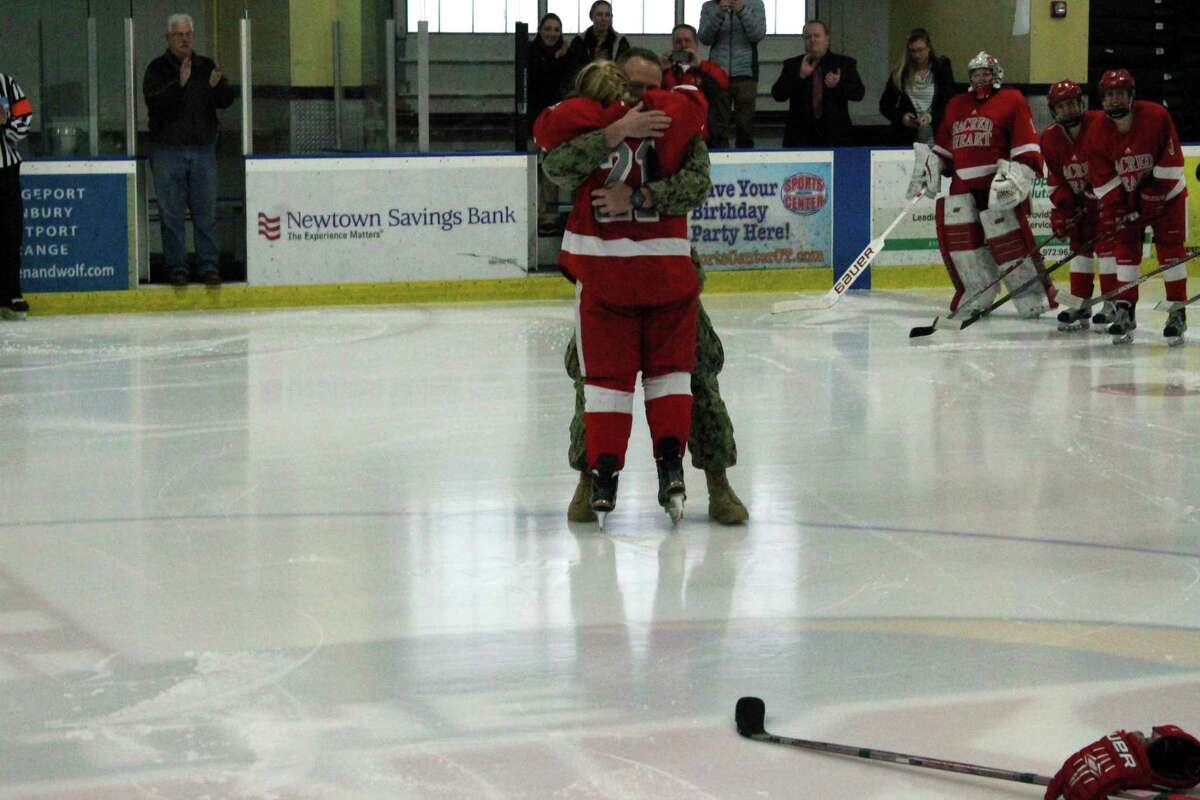 Navy Petty Officer 2nd Class Trevor Ketchum embraces his sister, Teagan, a Sacred Heart University senior, before Saturday's playoff game against St. Anslem at The Rinks at Shelton in Shelton, Conn. on Saturday, Feb. 25, 2017. Trevor surprises his sister, having just come home from deployment in support of Operation Enduring Freedom with the U.S. Navy.