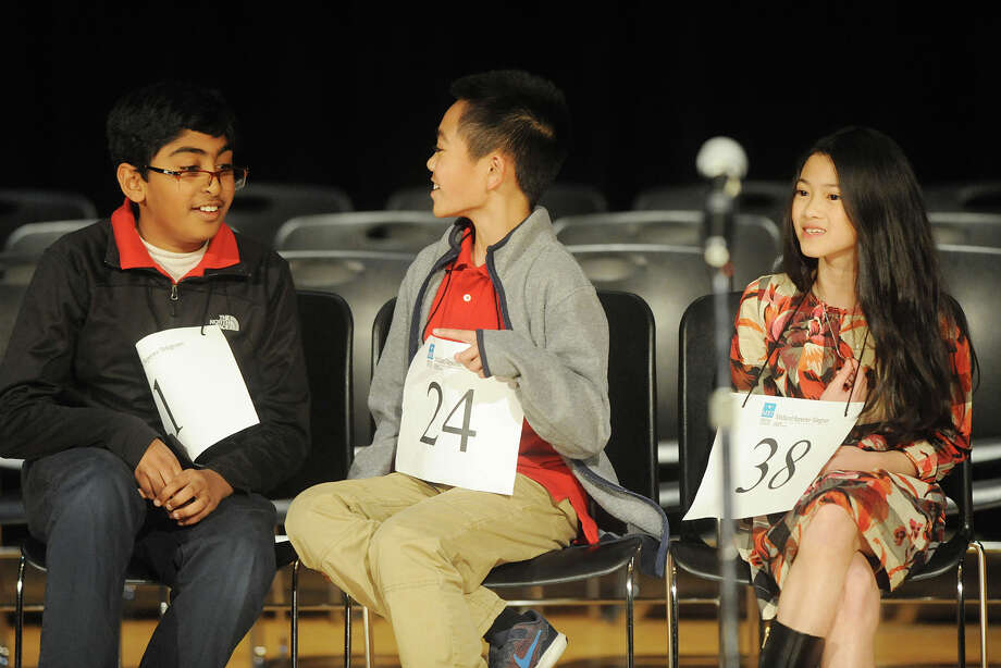 Srikar Chamarthi, from left, Jaiden Catalasan, and Prayer Lorskulsint, take a break between rounds during the Midland Reporter-Telegram's 30th annual regional Spelling Bee last year at Midland College. All three students are set to compete in this year's bee. Photo: James Durbin