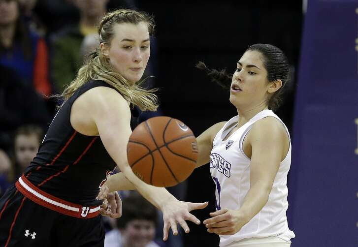 Washington's Kelsey Plum, right, passes the ball in front of Utah's Paige Crozon in the first half of an NCAA college basketball game Saturday, Feb. 25, 2017, in Seattle. (AP Photo/Elaine Thompson)