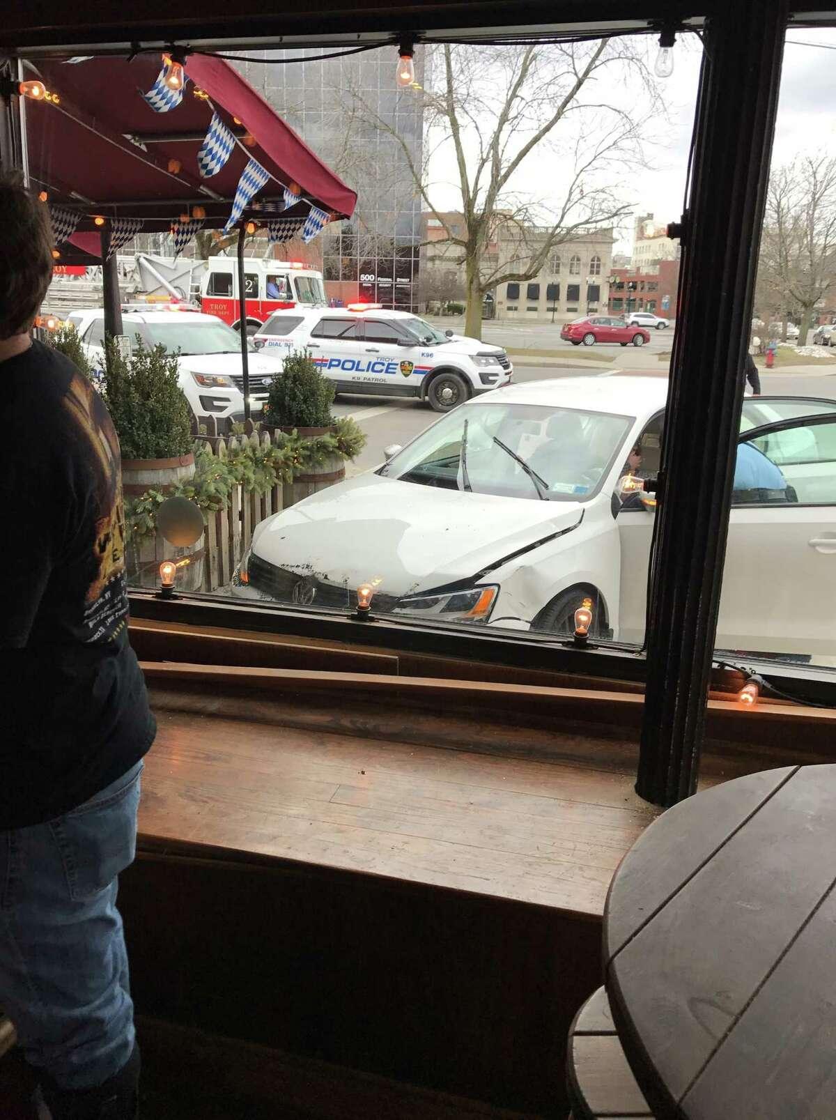 A car crashed outside Wolff's Biergarten in Troy on Saturday, Feb. 25, 2017.