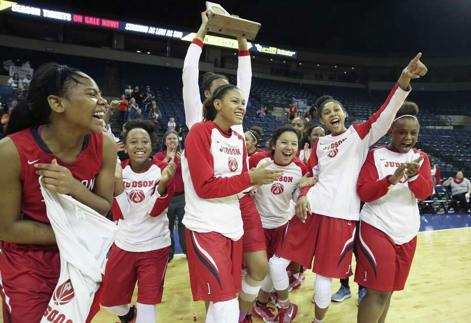 The Rockets celebrate with the trophy as Judson beats Brandeis at the Laredo Energy Arena in the Region IV-6A final of girls basketball on Feb. 25, 2017. Photo: Tom Reel /San Antonio Express-News / 2017 SAN ANTONIO EXPRESS-NEWS