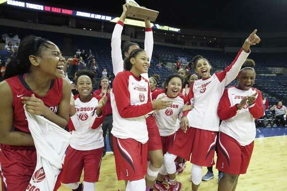 The Rockets celebrate with the trophy as Judson beats  Brandeis at the Laredo Energy Arena in the Region IV-6A final of girls basketball on February 25, 2017.
