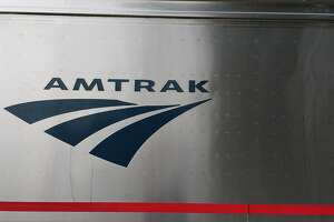 Amtrak logo on a passenger car.