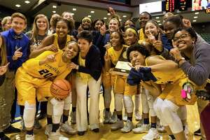 Cypress Ranch head coach Tresa Martin-Hornsby celebrates on the court with her team after defeating Clear Springs 59-56 in the class 6A region III final at Merrell Center on Saturday, Feb. 25, 2017, in Katy.