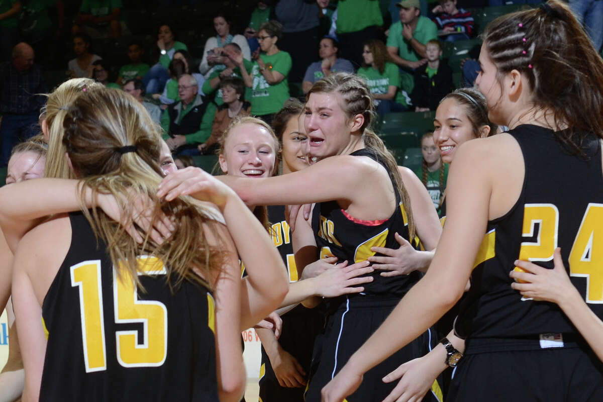 Canadian basketball players celebrate after beating Wall in the Region 1-3A girls basketball championship game Saturday, Feb. 25, 2017, at Chaparral Center. James Durbin/Reporter-Telegram