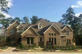 A new style of luxury townhome by Coventry's Homes has debuted in Grand Central Park with an exterior look and feel of a large estate home