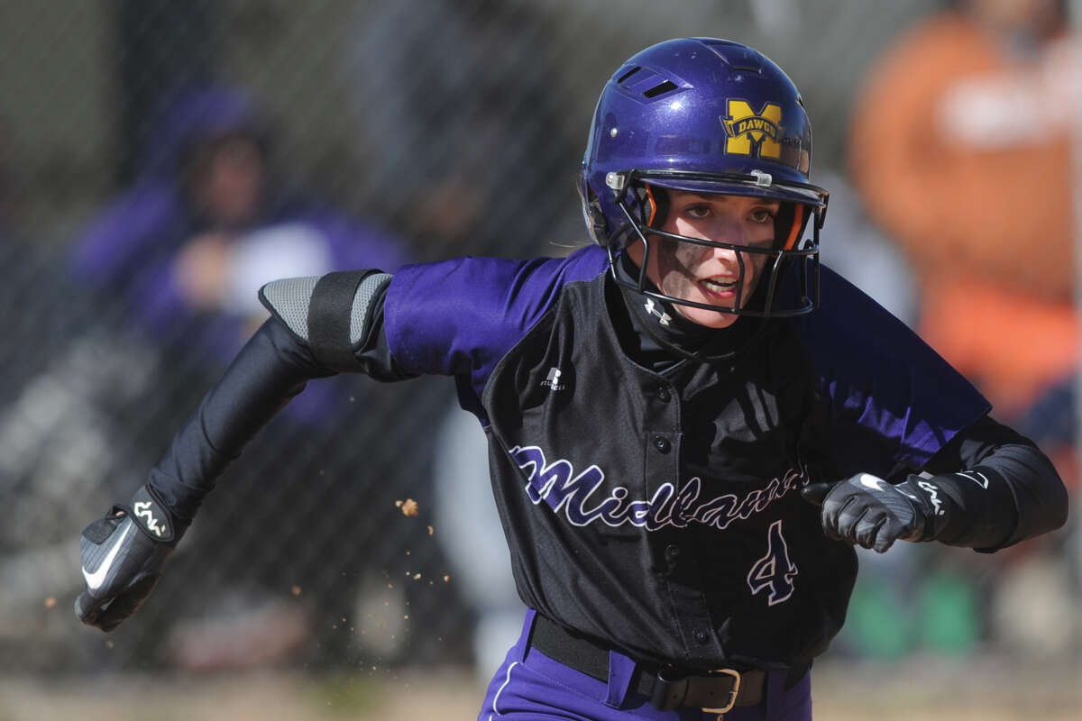 Midland High's Shea Keithley (4) runs after hitting against Shallowater on Saturday, Feb. 25, 2017, at Freddie Ezell Softball Complex. James Durbin/Reporter-Telegram