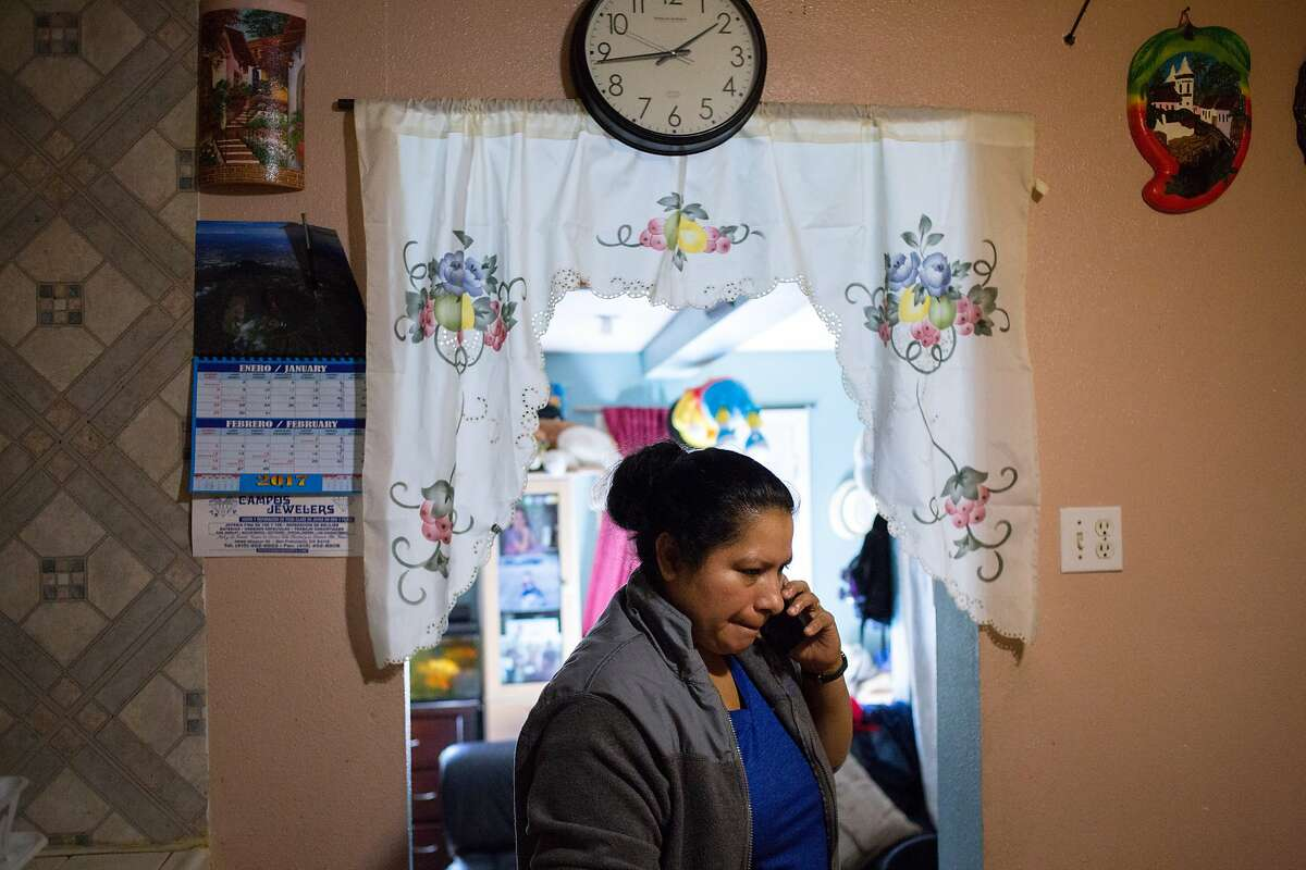 Over the phone, Olga Diaz talks to her son Arturo Rojas on Saturday, Feb. 25, 2017, in San Francisco, Calif. Rojas is being held in custody. He managed to obtain a U.S. visa and flew to San Francisco last month, only to be stopped by immigration agents, who confiscated his visa and ordered him held for deportation. Diaz said her son calls her almost every day since being held in January. They are from El Salvador.