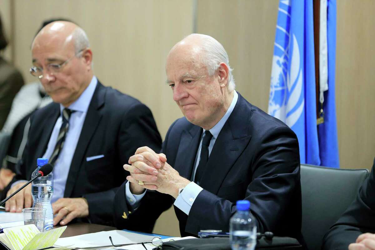 UN Special Envoy for Syria Staffan de Mistura, right, attends a meeting of Intra-Syria peace talks with Syrian government delegation at Palais des Nations in Geneva, Switzerland, Saturday, Feb. 25, 2017. (Pierre Albouy/Pool Photo via AP) ORG XMIT: LON166