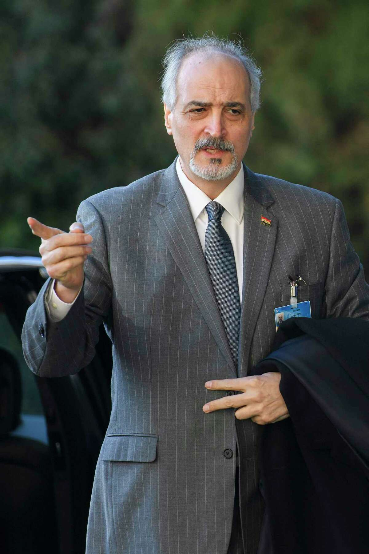 Syrian chief negotiator Bashar Ja?'afari, Ambassador of the Permanent Representative Mission of Syria to UN New York, arrives for a round of negotiation between the Syrian government and the UN Special Envoy for Syria Staffan de Mistura, at the European headquarters of the United Nations in Geneva, Switzerland, Saturday, Feb. 25, 2017. (Martial Trezzini/Keystone via AP) ORG XMIT: GE413