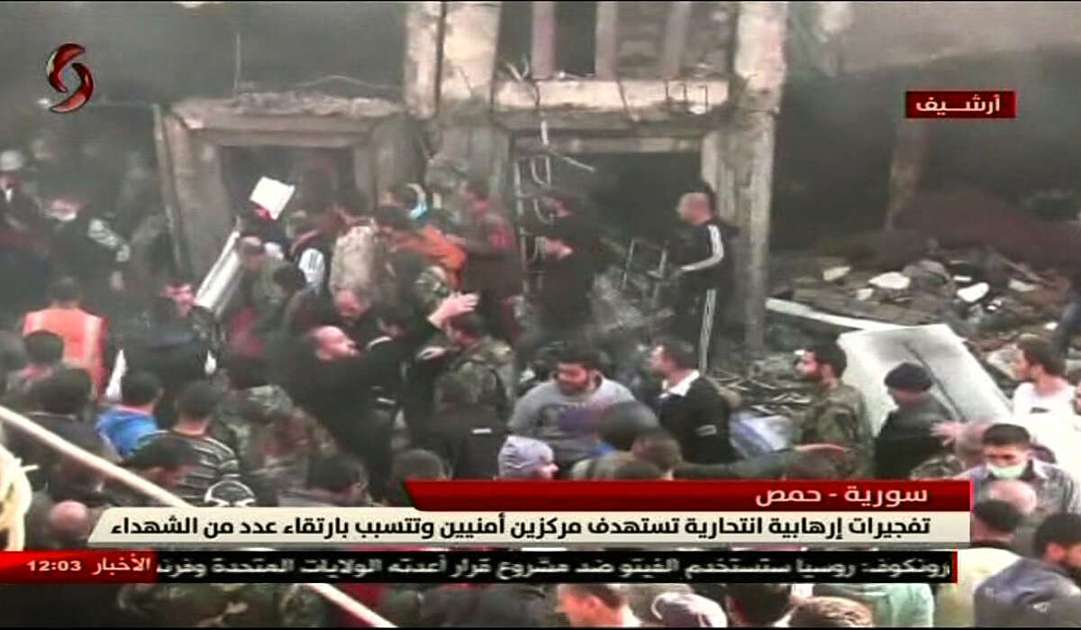 An image grab taken from a video broadcasted by the Al-Ikhbariya Al-Souriya TV channel on February 25, 2017 shows the aftermath following a suicide attack on two security service headquarters in Syria's third city, Homs. / AFP PHOTO / AL-IKHBARIYAH AL-SOURIYAH / HO / == RESTRICTED TO EDITORIAL USE - MANDATORY CREDIT