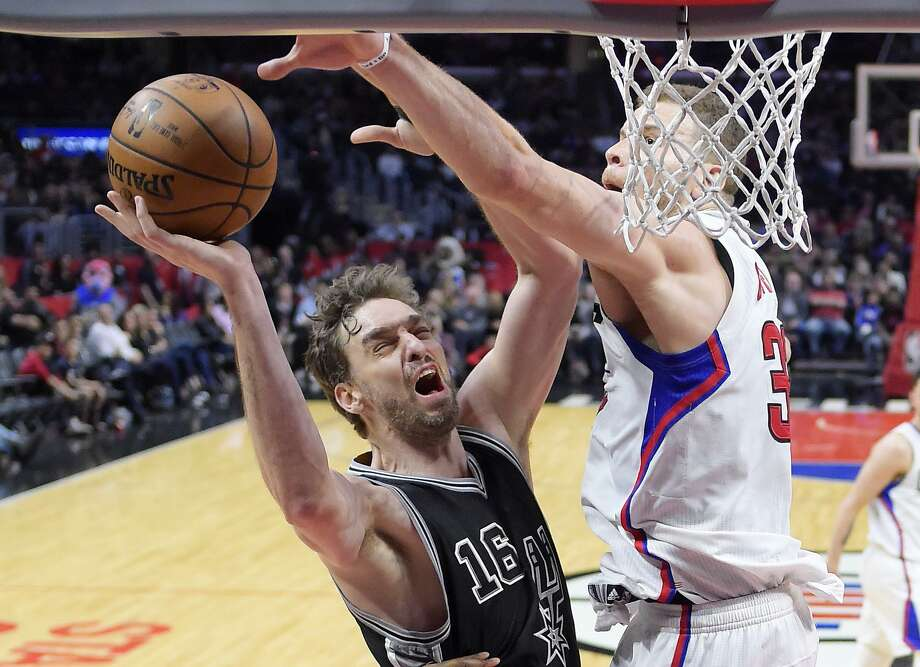San Antonio Spurs center Pau Gasol, left, of Spain, shoots as Los Angeles Clippers forward Blake Griffin defends during the second half of an NBA basketball game, Friday, Feb. 24, 2017, in Los Angeles. The Spurs won 105-97. (AP Photo/Mark J. Terrill) Photo: Mark J. Terrill, STF / Associated Press / Copyright 2017 The Associated Press. All rights reserved.