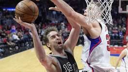 San Antonio Spurs center Pau Gasol, left, of Spain, shoots as Los Angeles Clippers forward Blake Griffin defends during the second half of an NBA basketball game, Friday, Feb. 24, 2017, in Los Angeles. The Spurs won 105-97. (AP Photo/Mark J. Terrill)