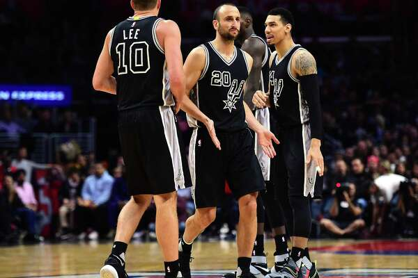 LOS ANGELES, CA - FEBRUARY 24:  Manu Ginobili #20 of the San Antonio Spurs celebrates his play with David Lee #10 and Danny Green #14 during a 105-97 win over the LA Clippers at Staples Center on February 24, 2017 in Los Angeles, California.  NOTE TO USER: User expressly acknowledges and agrees that, by downloading and or using this photograph, User is consenting to the terms and conditions of the Getty Images License Agreement.  (Photo by Harry How/Getty Images)