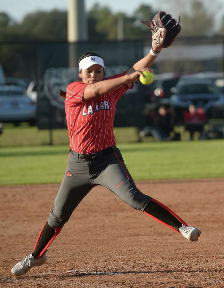 Lamar's Ciara Luna fires off a pitch from the mound as they face Big 12 opponent Kansas Saturday. Photo taken Saturday, February 25, 2017 Kim Brent/The Enterprise Photo: Kim Brent