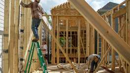 Immigrant construction workers, who all moved here from Mexico, build a house off West 23rd Street Friday, Feb. 24, 2017 in Houston. ( Michael Ciaglo / Houston Chronicle )