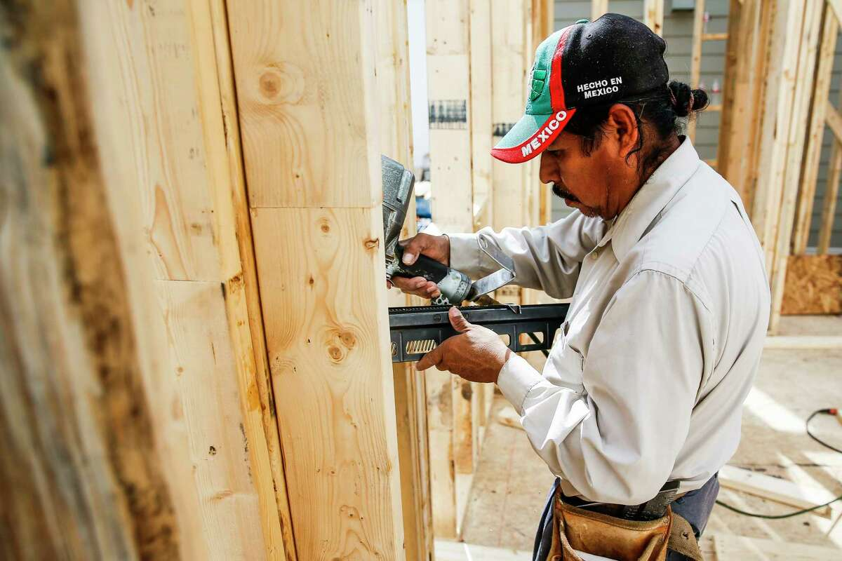An immigrant construction worker, who declined to give his name but moved here from Mexico, builds a house off West 23rd Street Friday, Feb. 24, 2017 in Houston. ( Michael Ciaglo / Houston Chronicle )