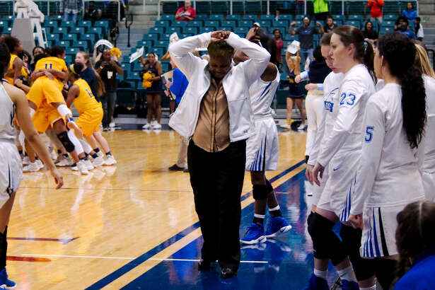 Clear Springs girls basketball coach Pam Crawford ducks her head in silence as Cypress Ranch celebrates their victory over Springs in the Region III-6A basketball playoff final game Saturday, Feb. 25 at  the Merrell Center in Katy, TX.