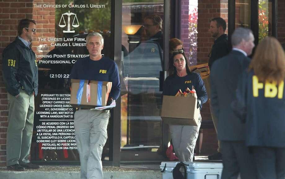 FBI agents carry boxes as they leave state Sen. Carlos Uresti's law offices in San Antonio on Feb. 16. Photo: Bob Owen /San Antonio Express-News / ©2017 San Antonio Express-News