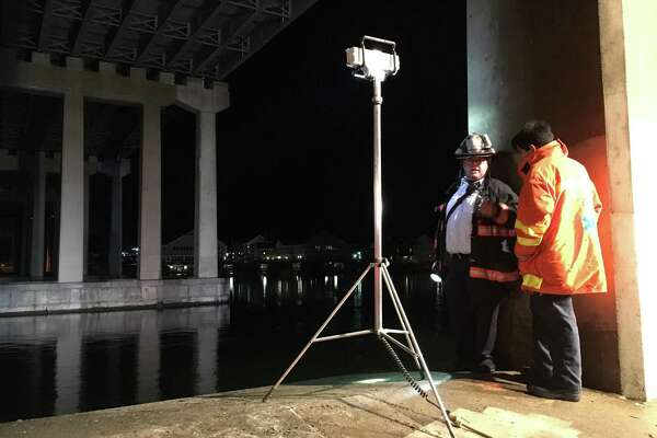 Emergency crews shine a spotlight on the Saugatuck River Saturday, Feb. 25 in the search for a couple.