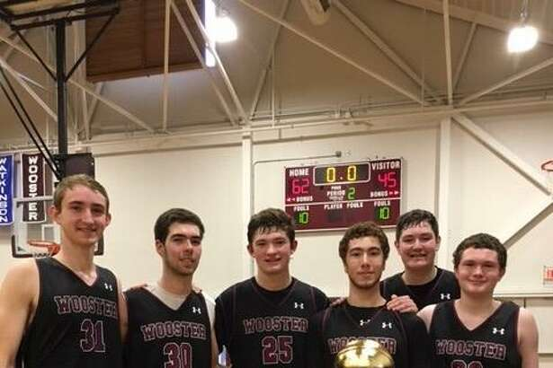 Seniors on the Wooster boys basketball team with the HVAL trophy, from left, Sam Cox, Alex Foote, Kern Byrnes, Arda Buyuklu, Stephen Perrault and Brogan Heneghan.