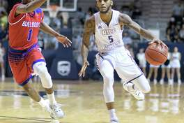 Ako Adams (5) of the Rice Owls brings the ball up the court in front of Derric Jean (1) of the Louisiana Tech Bulldogs in a college basketball game on Saturday, February 25, 2017 at Tudor Fieldhouse on Rice Campus.