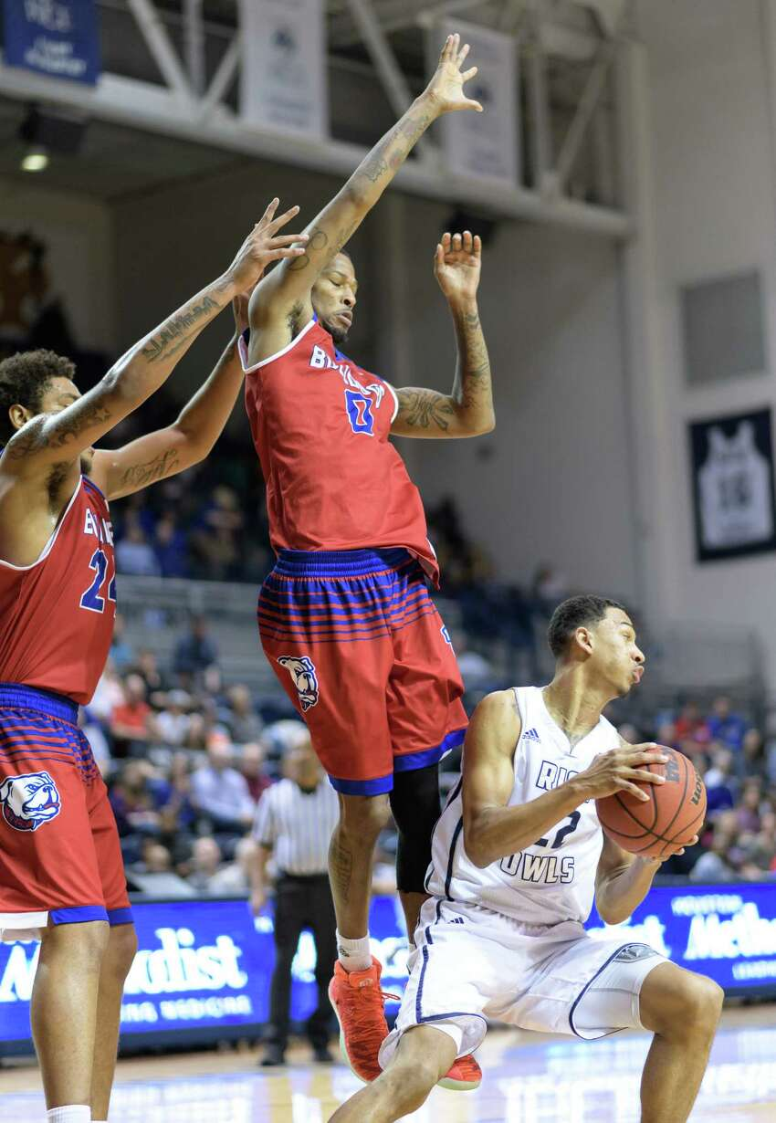 Marcus Jackson (22) of the Rice Owls is turned away from the basket by Jacobi Boykins (0) and Omar Sherman (24) of the Louisiana Tech Bulldogs in a college basketball game on Saturday, February 25, 2017 at Tudor Fieldhouse on Rice Campus.