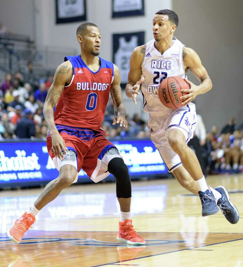 Marcus Jackson (22) of the Rice Owls brings the ball up the court with Jocobi Boykins (0) of the Louisiana Tech Bulldogs defending in a college basketball game on Saturday, February 25, 2017 at Tudor Fieldhouse on Rice Campus.
