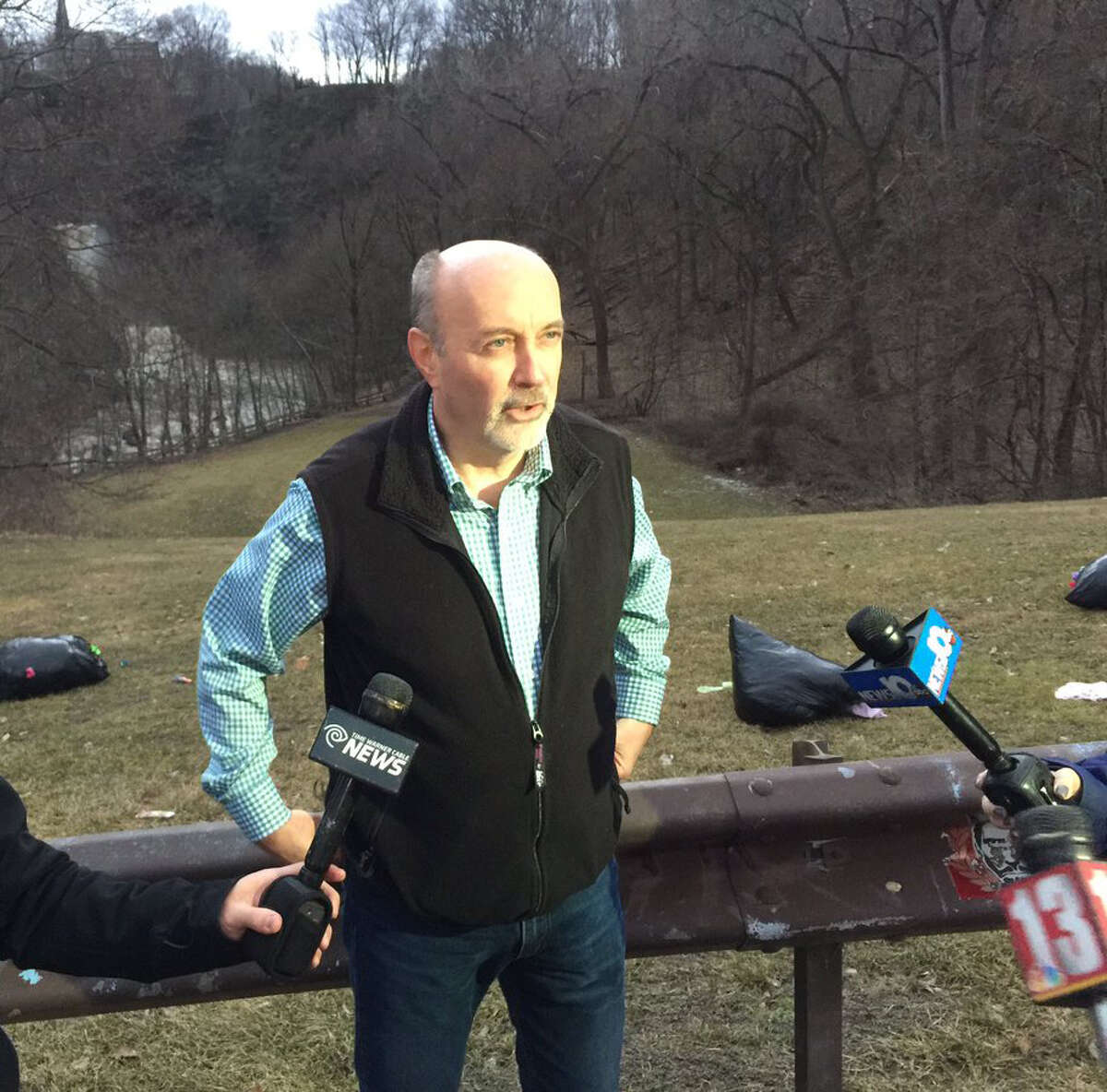 Troy Mayor Patrick Madden speaks to the press near the Poestenkill Gorge where witnesses reported a man fell into the water and did not resurface on Saturday, Feb. 25, 2017.