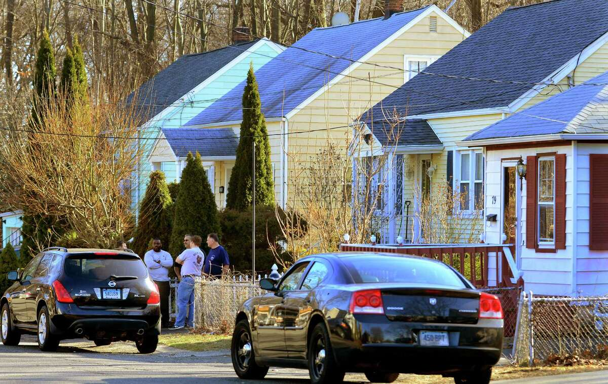 Detectives investigate the scene of a homicide in Bridgeport, Conn. A citizen of El Salvador, Oscar Hernandez was wanted for killing his daughter's mother. He fled Connecticut with his 6-year-old child and was later captured in Pennsylvania.