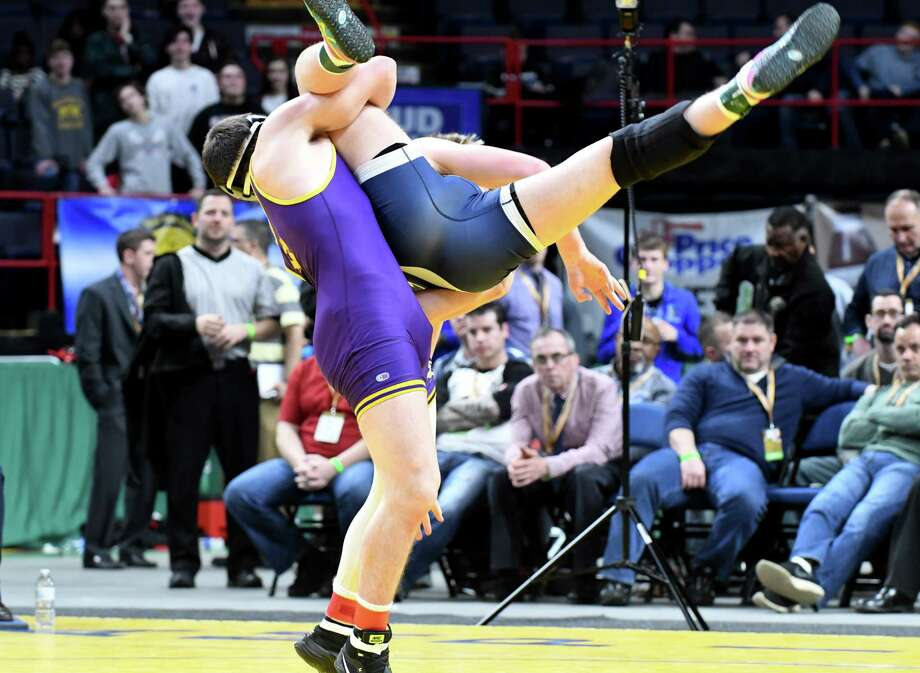 Tyler Barnes of Ballston Spa High School wrestles Zach Ancewicz from John Glen to claim the 170-pound Division I wrestling title during the New York State Wrestling Championships on Saturday, Feb. 25, 2017, at the Times Union Center in Albany, N.Y. (Will Waldron/Times Union) Photo: Will Waldron / 20039779A