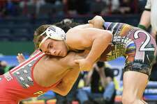 Kiernan Shanahan from Shenendehowa High School, right, battles Frankie Gissendanner for the 145-pound Division I title during the New York State Wrestling Championships on Saturday, Feb. 25, 2017, at the Times Union Center in Albany, N.Y. Gissendanner took the title. (Will Waldron/Times Union)