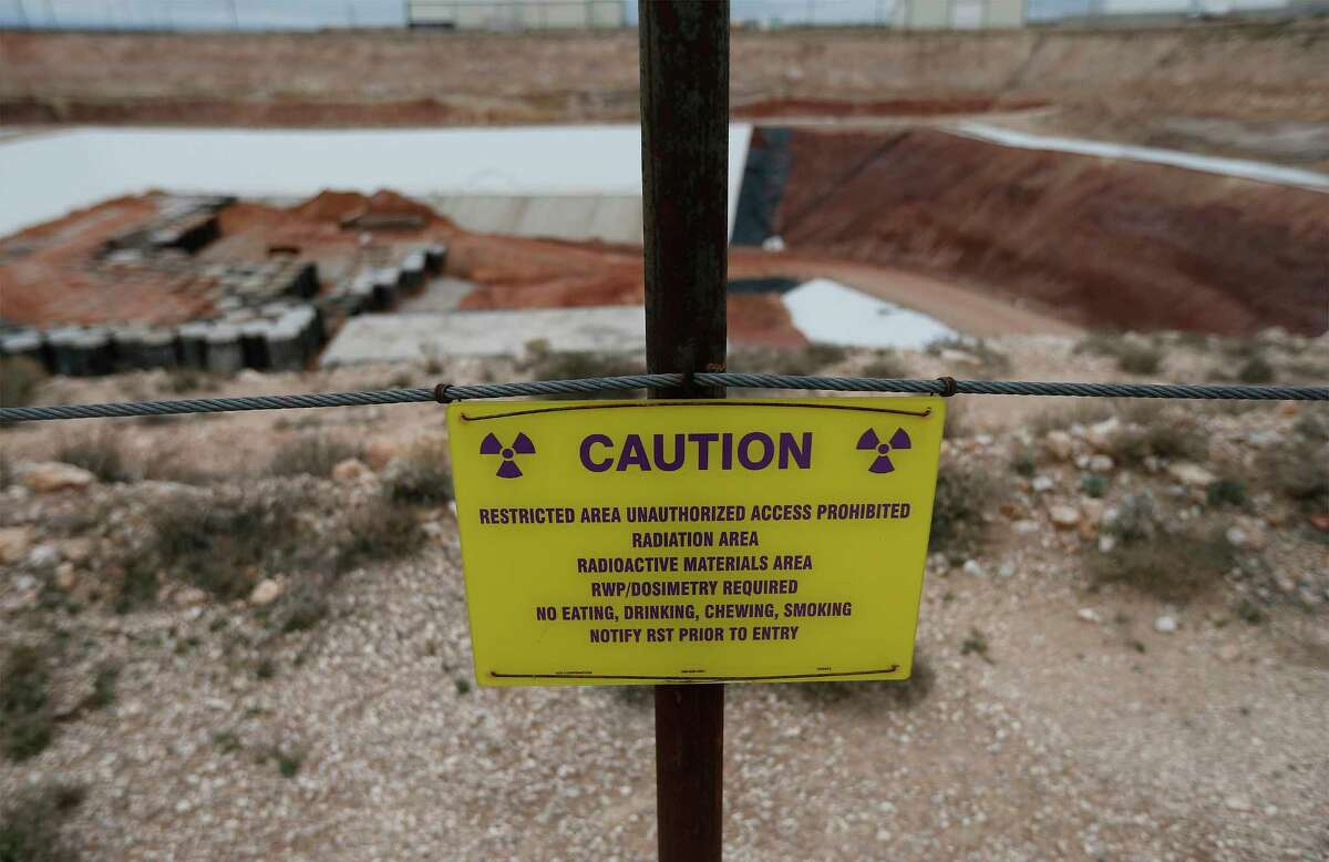 A caution sign surrounding the low-level radioactive waste site at Waste Control Specialists (WCS) near Andrews, Texas.