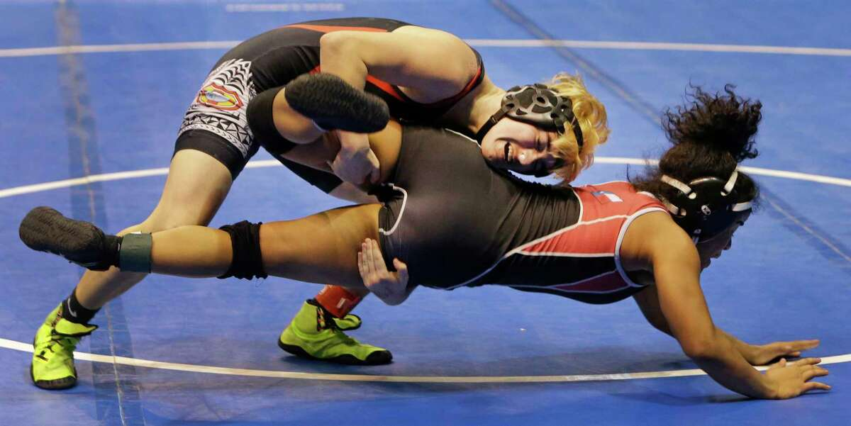Mack Beggs, top, a transgender wrestler from Euless Trinity High School, is shown during a quarterfinals match against Mya Engert of Amarillo Tascosa during the State Wrestling Tournament at the Berry Center, 8877 Barker Cypress Road, Friday, Feb. 24, 2017, in Cypress. Beggs was born a girl and is transitioning to male but wrestles in the girls division. ( Melissa Phillip / Houston Chronicle )