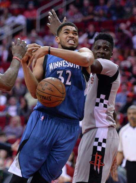 Minnesota Timberwolves center Karl-Anthony Towns (32) loses the ball after being fouled while driving against Houston Rockets center Clint Capela, right, in the first half of an NBA basketball game Saturday, Feb. 25, 2017, in Houston. (AP Photo/George Bridges) Photo: George Bridges, FRE / FR171217 AP