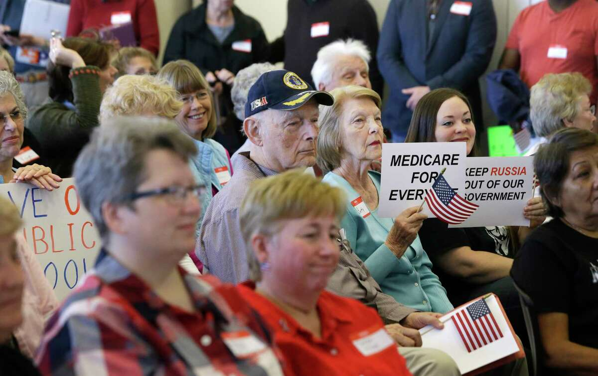 People listen during at an event billed as a town hall of the constituents of the 8th Congressional District held at Conroe Tower, 300 W. Davis Street, Saturday, Feb. 25, 2017, in Conroe. The district is represented by Kevin Brady (R-Woodlands).