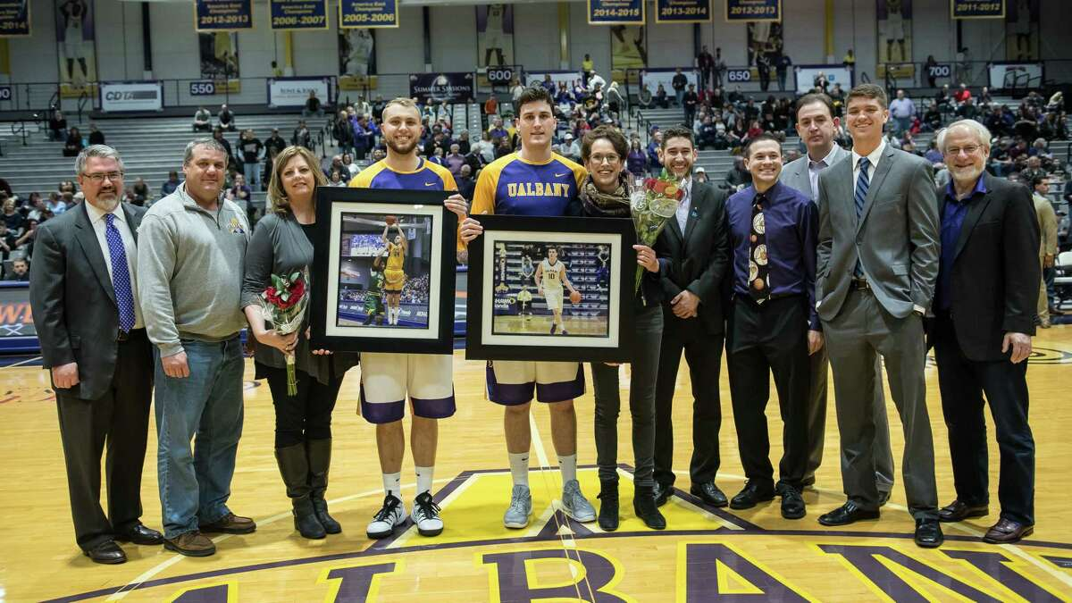 UAlbany seniors Mike Rowley and Dallas Ennema are honored before the game Saturday night as part of Senior Day. (Bill Ziskin / UAlbany)