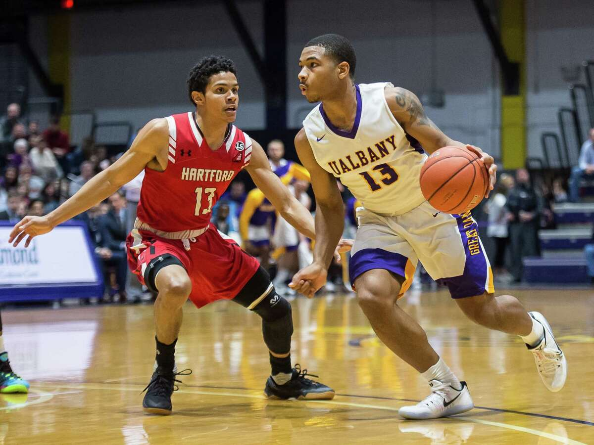 UAlbany's David Nichols makes a move to the basket Saturday during the Great Danes' win over Hartford. (Bill Ziskin / UAlbany Athletics)
