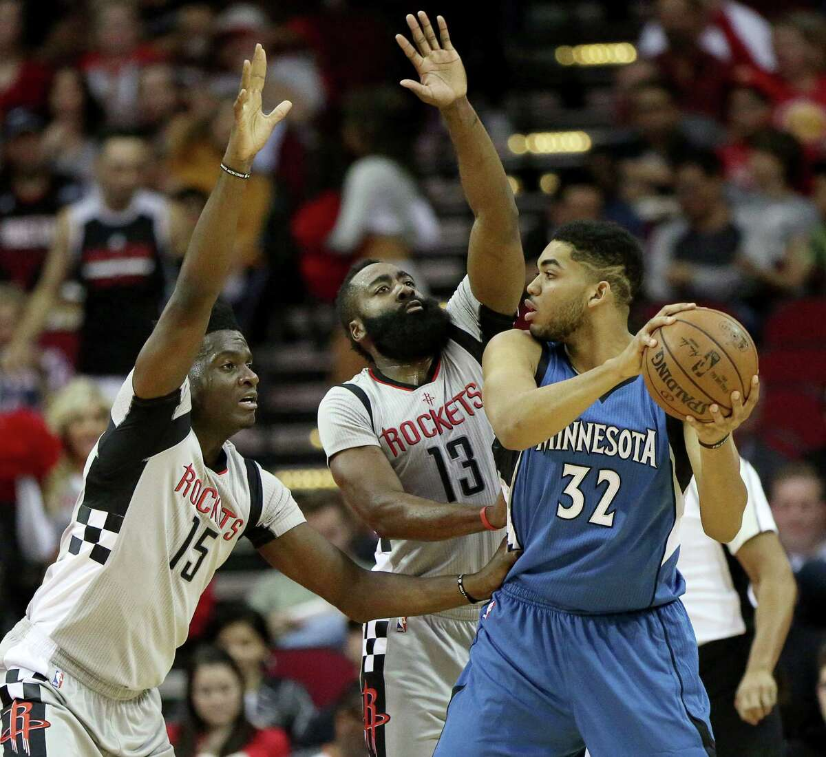 Houston Rockets players Clint Capela (15) and James Harden (13) guarding Minnesota Timberwolves center Karl-Anthony Towns (32) together during the first quarter of the game at Toyota Center Saturday, Feb. 25, 2017, in Houston.