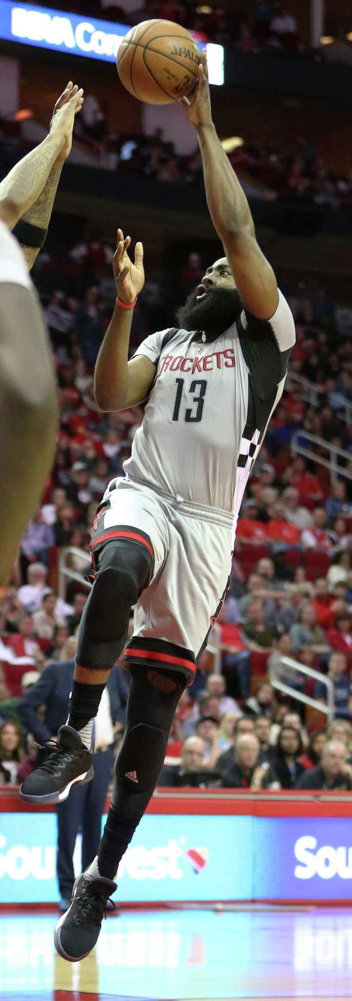 Houston Rockets guard James Harden (13) aims for the basket during the second quarter of the game at Toyota Center Saturday, Feb. 25, 2017, in Houston.